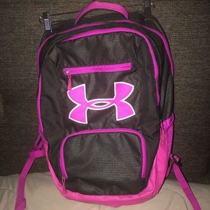 Under Armour pink and black waterproof backpack